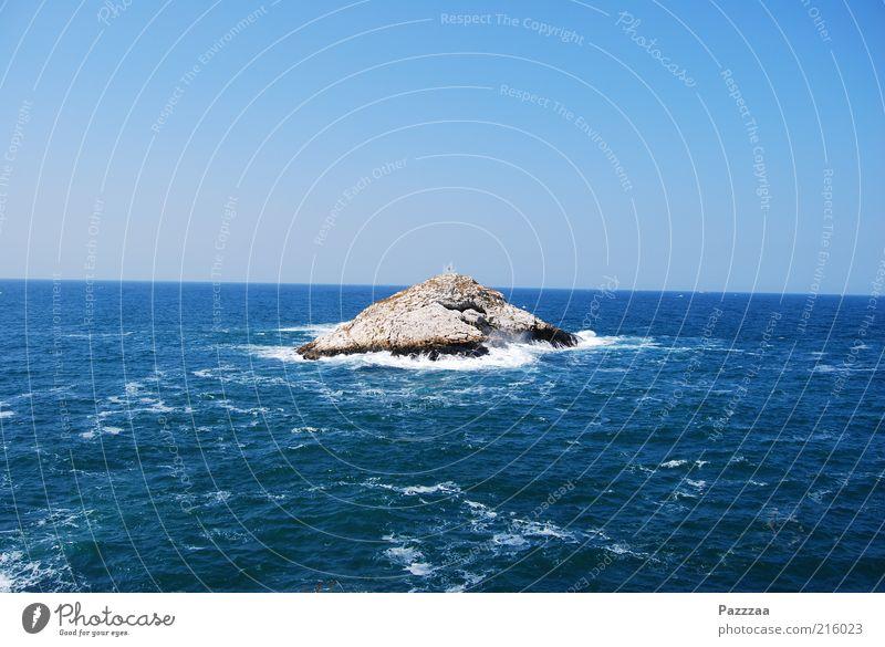 Straight island, crooked sea. Vacation & Travel Summer vacation Ocean Island Waves Wet Blue Black Sea White crest Foam Blue sky Horizon Turkey Rock Colour photo