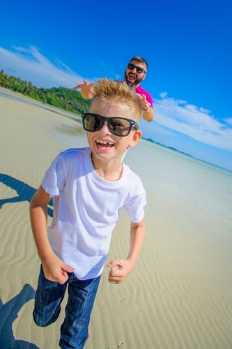 Father and son running along the tropical beach Human being Child Nature Vacation & Travel Man Blue Summer Colour Beautiful White Landscape Ocean Joy Beach