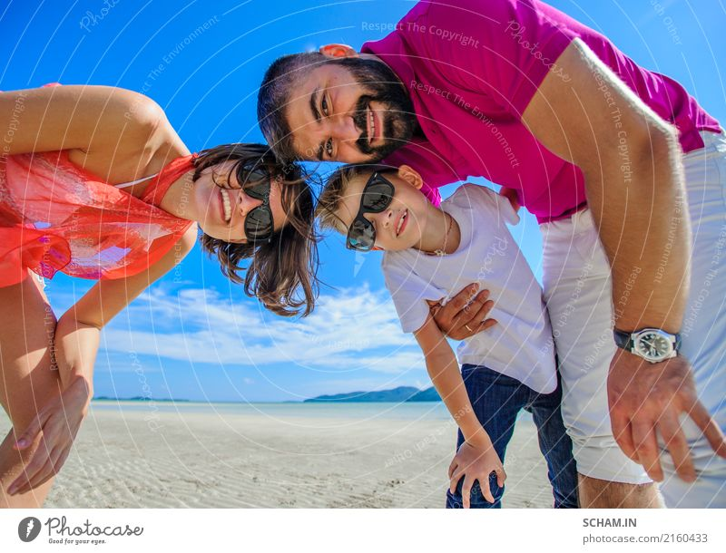The happiest childhood: father, mother and son having fun on the tropical beach Lifestyle Joy Playing Summer Ocean Island Infancy Landscape Sunglasses Beard