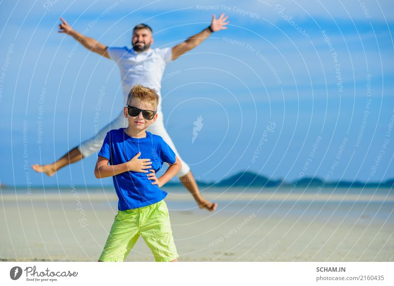 Happy father and son at the tropical beach, laughing and enjoying time together Lifestyle Joy Playing Summer Ocean Island Infancy Landscape Sunglasses Beard
