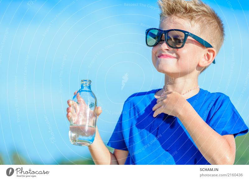Portrait of a thirsty handsome boy in sunglasses drinking water Child Man Summer Landscape Joy Adults Lifestyle Boy (child) Playing Infancy Happiness Island