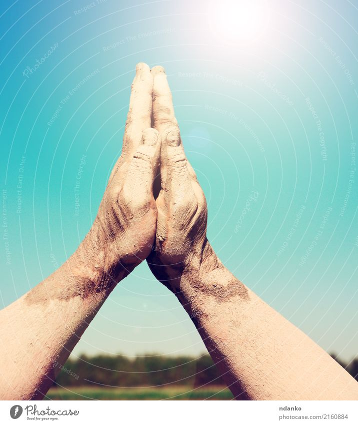 two male hands stacked togethe Sky Heaven Blue Sun Hand Religion and faith Bright Prayer Gesture