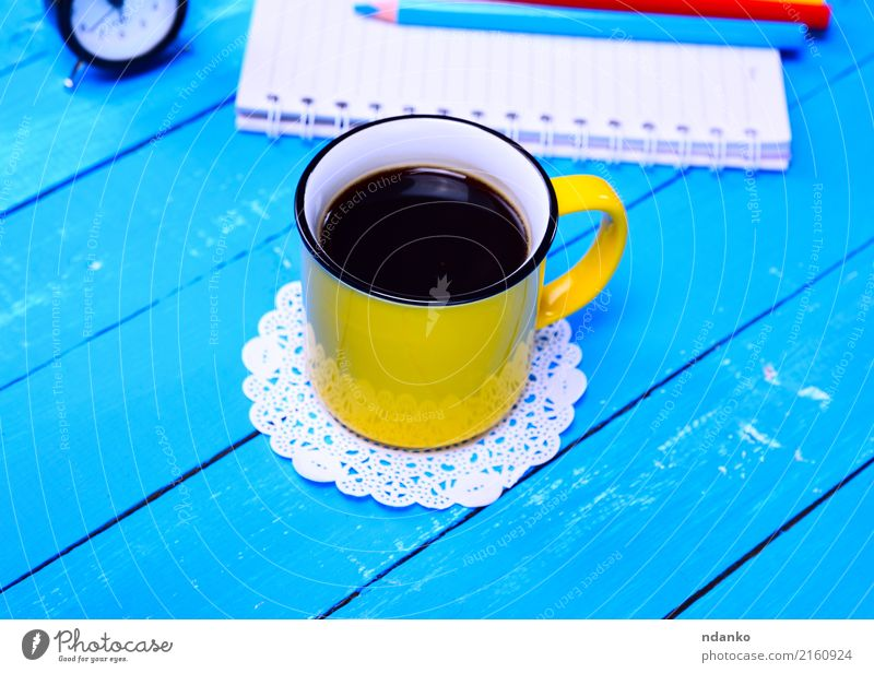 Black coffee in a yellow mug Breakfast To have a coffee Beverage Coffee Espresso Cup Table Restaurant Wood Fresh Hot Above Retro Yellow Café drink Fragrant Top