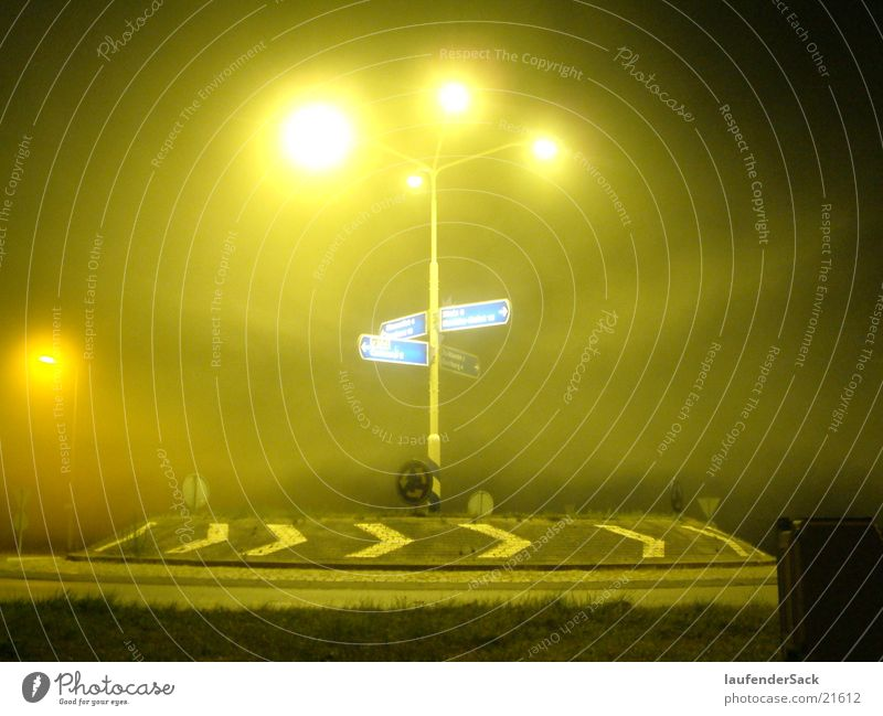 Roundabout in yellow Traffic circle Fog Night Lantern Long exposure yellow light Road marking
