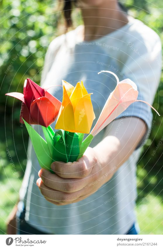Woman hold bouquet of origami flowers a royalty free stock photo woman hold bouquet of origami flowers a royalty free stock photo from photocase mightylinksfo