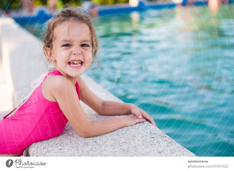Smile on the swimming pool Girl 1 Human being 3 - 8 years Child Infancy Water Summer Swimming pool Swimming trunks Blonde To enjoy Laughter Playing Emotions Joy