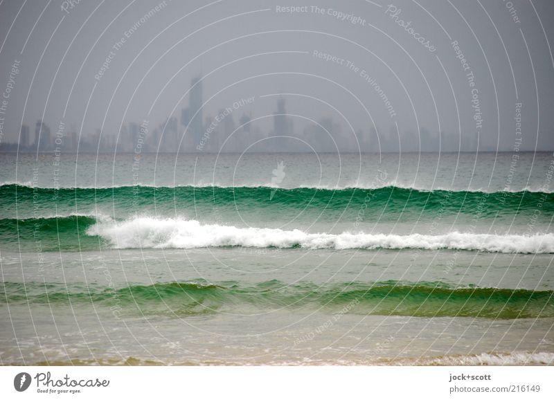 Sky City Green Water Ocean Far-off places Dark Environment Warmth Coast Gray Fog Waves Modern High-rise Future