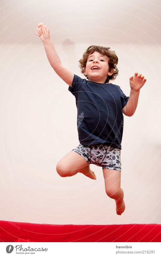 Human being Child Blue White Red Joy Sports Playing Boy (child) Movement Jump Funny Healthy Infancy Flat (apartment) Leisure and hobbies