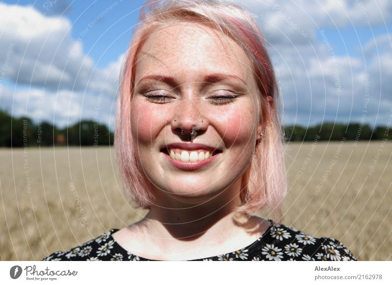 Portrait of a smiling young woman with freckles standing in front of a field Joy luck already Face Contentment Trip Summer Young woman Youth (Young adults)