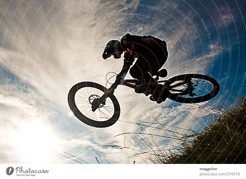 Mountain Bike Ski II Sports Cycling 1 Human being Movement Driving Cool (slang) Jump Subdued colour Exterior shot Day Worm's-eye view Mountain bike Helmet Sky