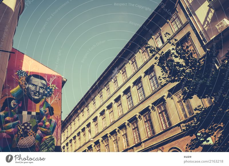 townsfolk Lifestyle Vacation & Travel Tourism Sightseeing City trip Art Work of art Culture Town Capital city Outskirts Old town Architecture Graffiti