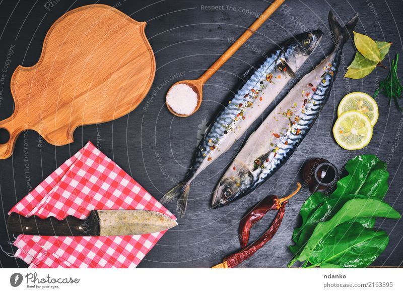 fresh mackerel fish with spices Nature Green Animal Black Natural Wood Nutrition Fresh Table Fish Herbs and spices Gastronomy Restaurant Dinner Knives Meal