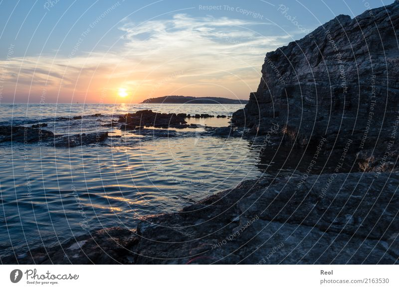 Sunset by the sea Nature Landscape Water Sky Sunrise Summer Rock Coast Ocean Mediterranean sea Vacation & Travel Blue Orange Rocky coastline Stone Croatia
