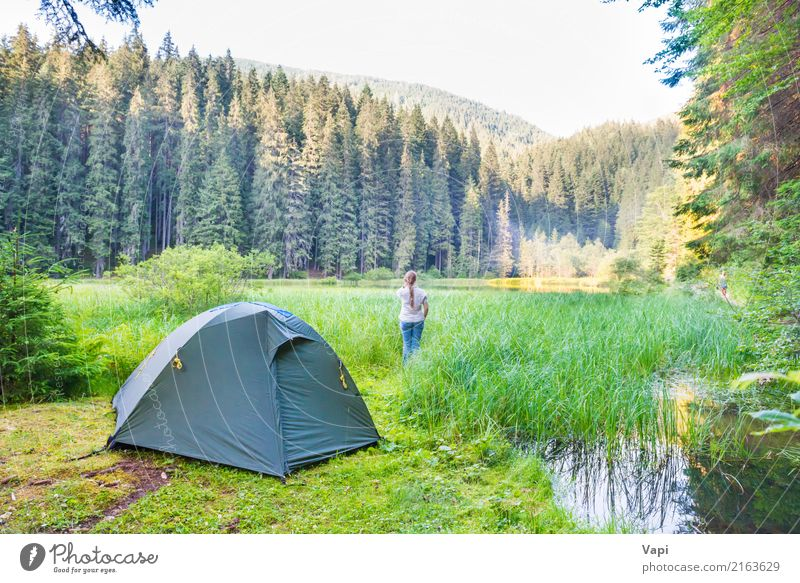 Young woman near green tent and forest lake Human being Woman Sky Nature Vacation & Travel Youth (Young adults) Plant Blue Summer Beautiful Green Water White