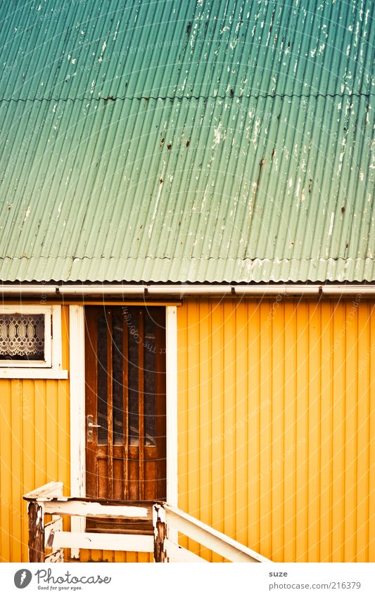 front door Living or residing Flat (apartment) House (Residential Structure) Hut Building Facade Door Roof Eaves Yellow Turquoise Føroyar Corrugated sheet iron