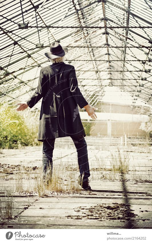 How much does the world cost Man floppy hat Frock coat Black Lifestyle Greenhouse 1 Human being Jeans Hat White-haired Decline Living or residing Future Empty