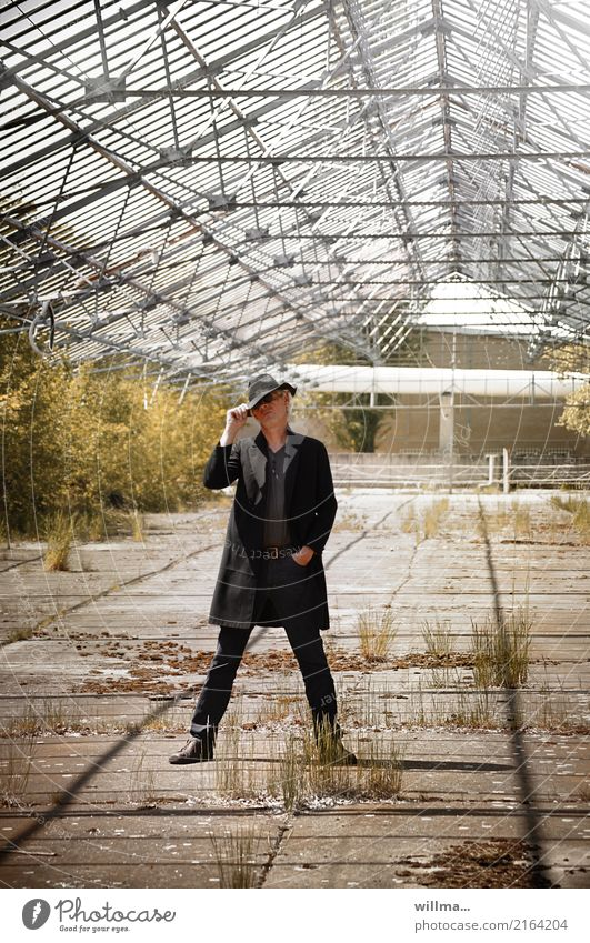 cool guy with floppy hat and frock coat post in empty greenhouse Man Frock coat Sunglasses Hat White-haired Cool (slang) Uniqueness Decline Easygoing Fashion