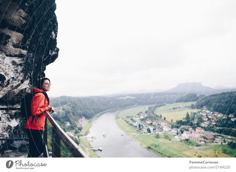 Hiking (07) Feminine Young woman Youth (Young adults) Woman Adults 1 Human being 18 - 30 years 30 - 45 years Adventure Nature Saxon Switzerland Rain jacket Red