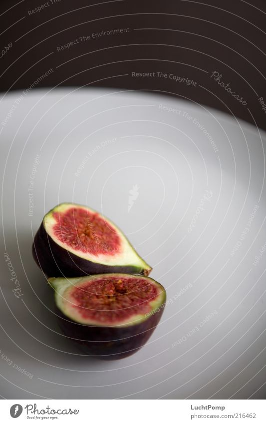 half&half Fig Red Violet Fruit flesh Juicy Fruity Sheath Sliced Plate Edge of a plate Brown Raw Healthy Delicious Mature Sweet Healthy Eating Nutrition