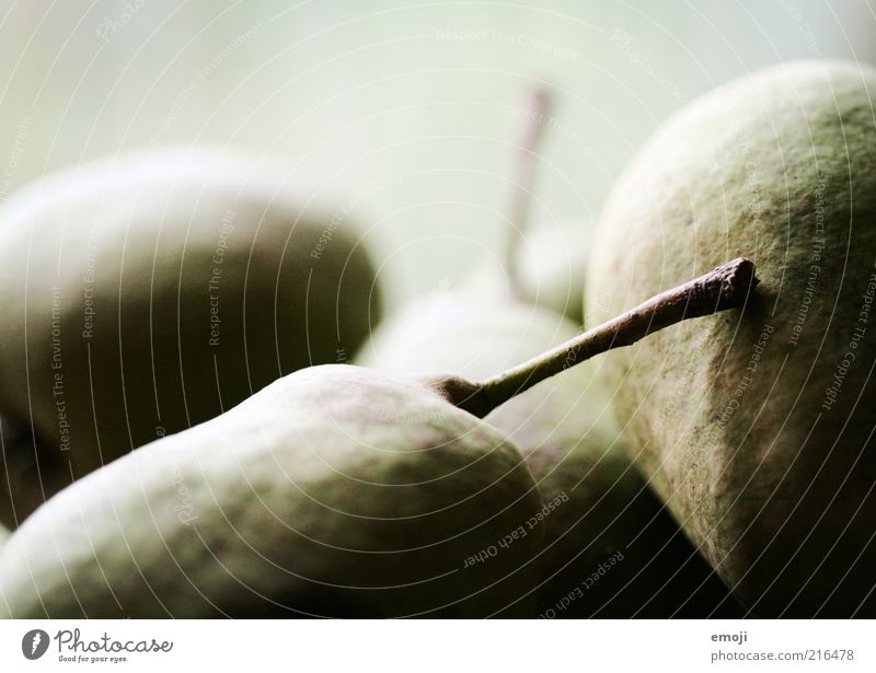 fruit Fruit Nutrition Organic produce Vegetarian diet Brown Green Healthy Eating Pear Pear stalk Close-up Colour photo Neutral Background Shadow