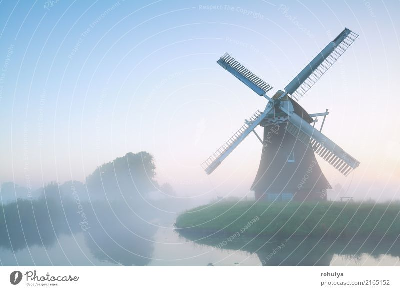 charming windmill in morning fog, Holland Vacation & Travel Culture Nature Landscape Sky Summer Beautiful weather Fog Pond Lake Building Architecture