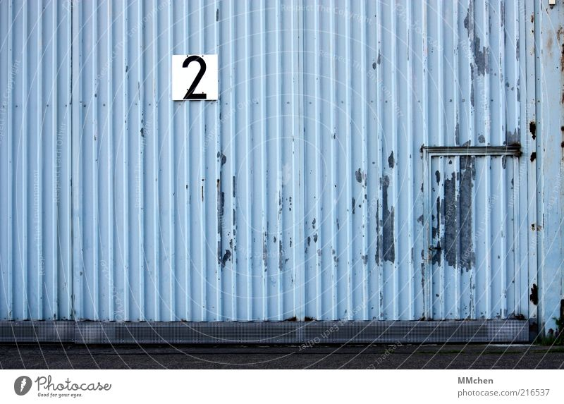 Gate number 2 Building Blue Warehouse Hall Tin Door Entrance Signs and labeling signage Digits and numbers Gray Hangar Colour photo Exterior shot Deserted