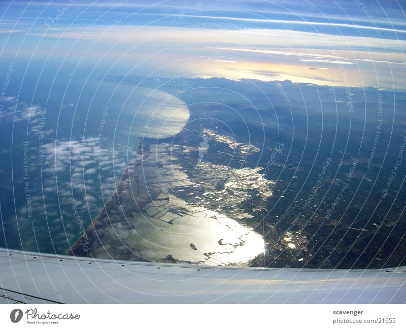 Water Beautiful Sun Ocean Clouds Far-off places Mountain Landscape Air Fog Horizon Vantage point Long Wing Wide Aerial photograph