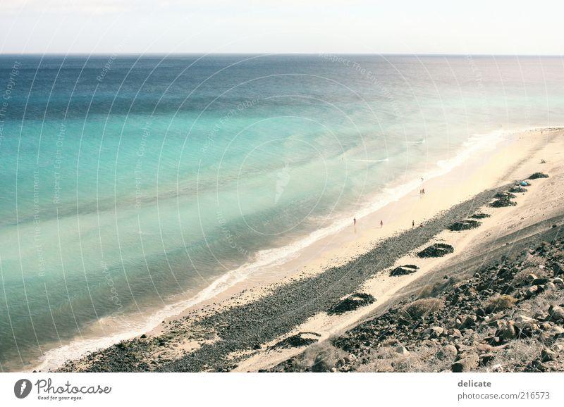 Sky Blue Water Ocean Far-off places Beach Coast Stone Sand Horizon Waves Island Bay Turquoise Surf Environment