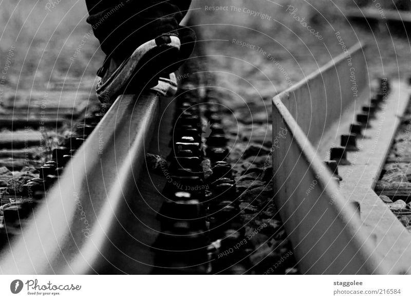 Human being Stone Footwear Going Walking Lifestyle Railroad tracks Sneakers Black & white photo Pedestrian Balance Rail transport Railroad system