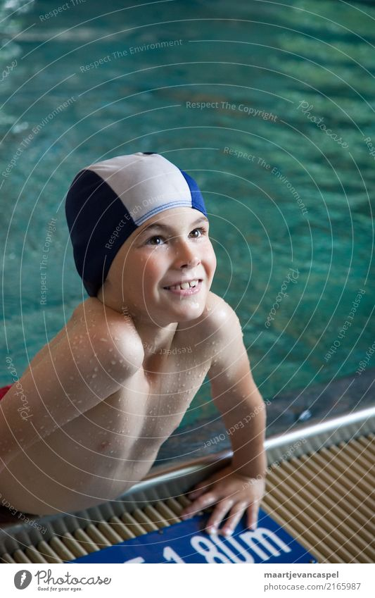 Happy little boy in swimming pool with bathing cap Human being Masculine Child Boy (child) Infancy 1 3 - 8 years Swimming trunks Bathing cap Swimming & Bathing