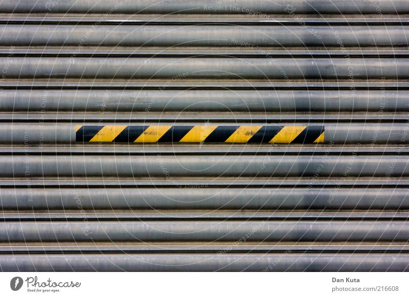 disorder Gate Metal Stripe Second-hand Dirty Oily Warn Warning colour Warning stripes Signs and labeling Caution Yellow Black yellow-black striated Colour photo