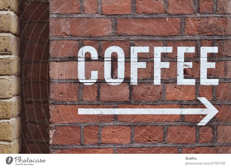 Coffee - please follow the arrow Wall (barrier) Wall (building) Facade Stone Characters Signs and labeling Signage Warning sign Discover To enjoy Drinking Retro