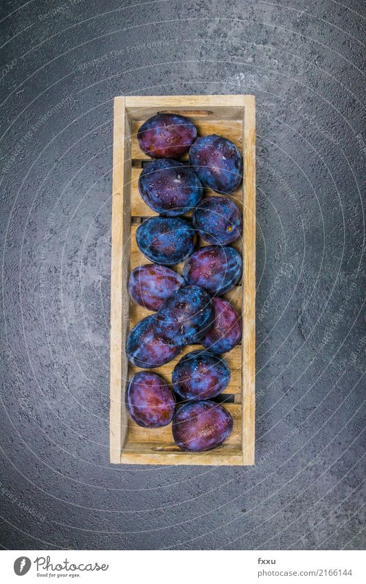Fresh plums in a wooden box Plum Fruit Splash of water Drops of water Healthy Healthy Eating To enjoy Nutrition Delicious Edible Beautiful Sweet Food