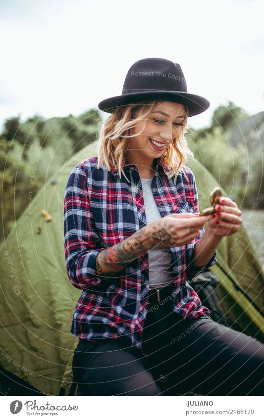Young woman is checking direction with compass Leisure and hobbies Vacation & Travel Trip Adventure Freedom Safari Expedition Camping Summer vacation Hiking