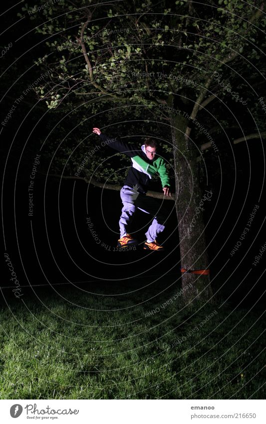 slack.jump.night. Joy Freedom Human being Masculine Young man Youth (Young adults) 1 18 - 30 years Adults Nature Tree Grass Movement Jump Athletic Uniqueness