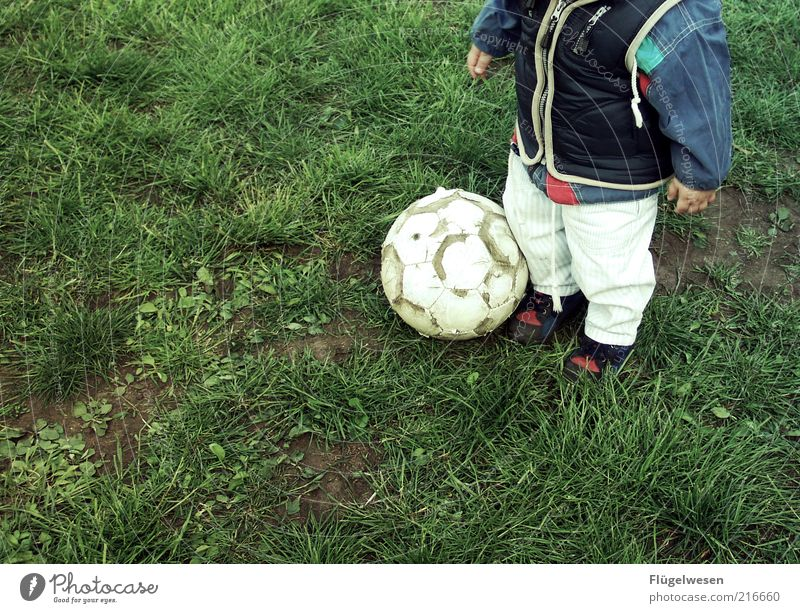 Human being Child Sports Boy (child) Meadow Playing Soccer Foot ball Ball Leisure and hobbies Infancy Toddler Fan Anonymous Parenting Partially visible