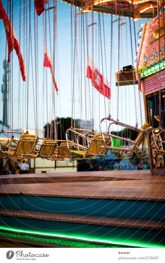 Riding the chain Leisure and hobbies Chairoplane Carousel Trip Feasts & Celebrations Fairs & Carnivals Cannstatter Wasen Chain Seat Lighting Driving Hang