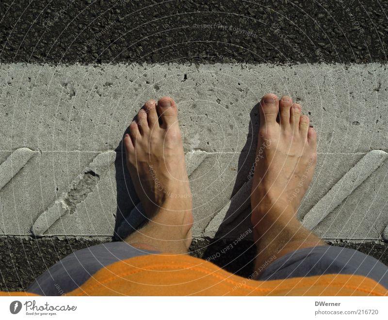 stand Human being Masculine Man Adults Legs Feet 1 Pants Stone Stand Wait Stagnating Asphalt Barefoot Summer Lane markings Colour photo Exterior shot Detail