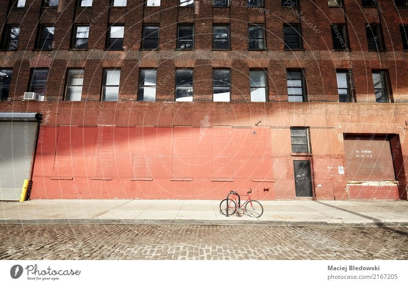 Bicycle on an empty street at sunset, New York City. Town Building Wall (barrier) Wall (building) Facade Transport Cycling Street Old bike Brooklyn NYC Sidewalk