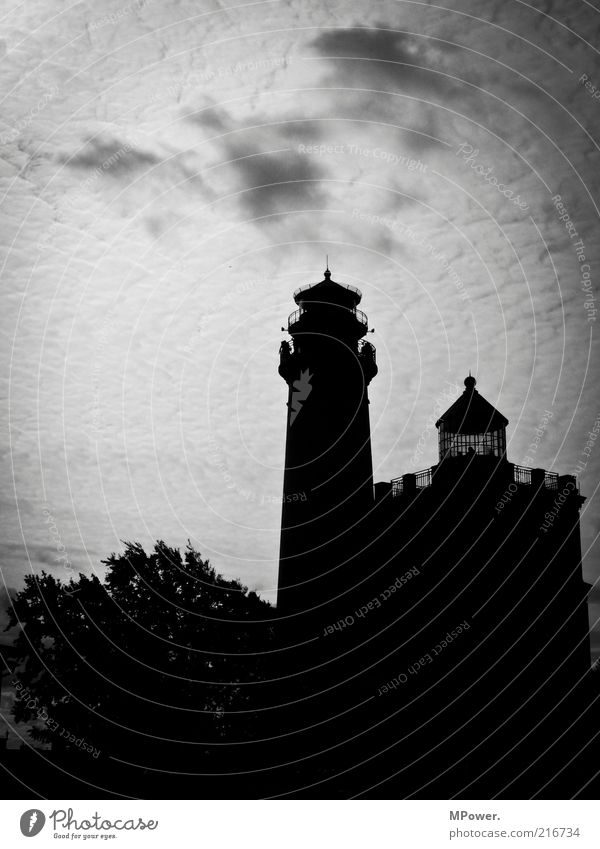 signpost Tower Lighthouse Manmade structures Building Architecture Tourist Attraction Landmark Monument Old Famousness Large Black White Clouds in the sky