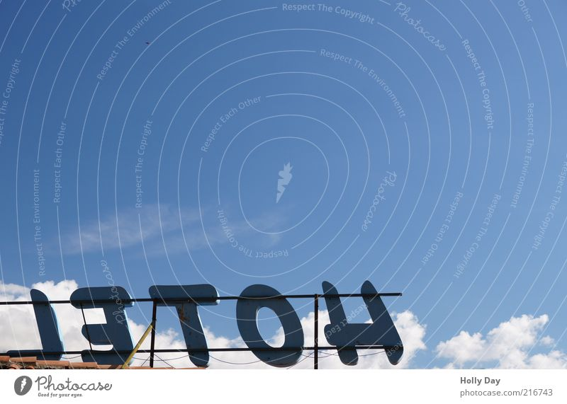 Sky Summer Vacation & Travel Clouds Signs and labeling Characters Hotel Services Beautiful weather Blue sky Section of image Capital letter Billboard