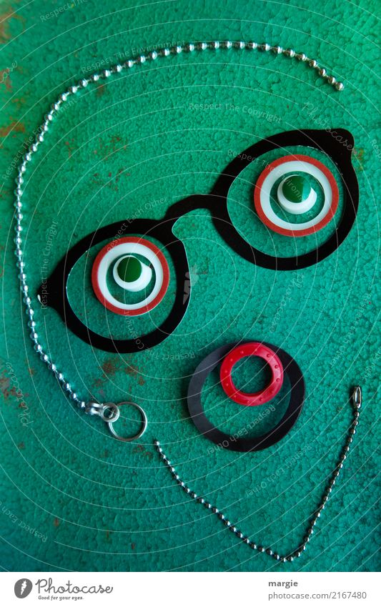 emotions...cool faces: collage face with necklace and glasses Business Human being Masculine Man Adults Face 1 Green Black Dedication Modest Eyeglasses Eyes