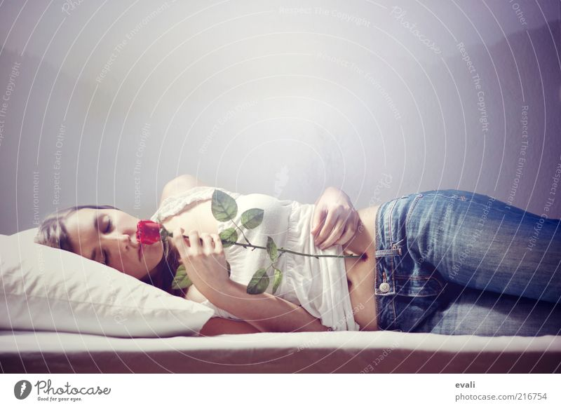 Woman Human being Youth (Young adults) White Blue Red Feminine Wall (building) Dream Adults Sleep Rose Jeans Bed Lie Pain