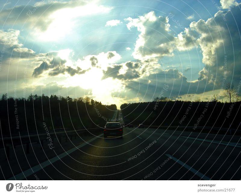 Sky Sun Blue Black Clouds Far-off places Street Forest Dark Lanes & trails Car Line Bright Transport Speed End