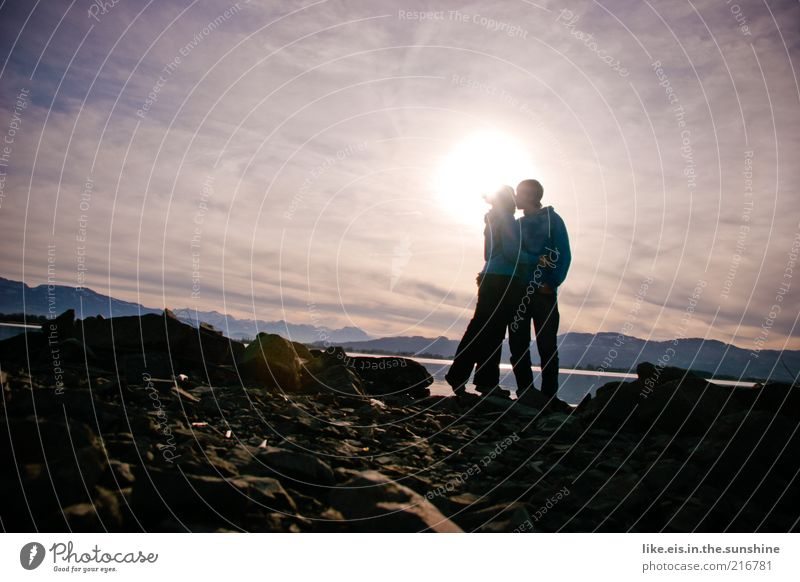Love is in the air Winter Masculine Feminine Young woman Youth (Young adults) Young man Couple Partner Life 2 Human being Sky Hill Rock Alps Mountain Lakeside