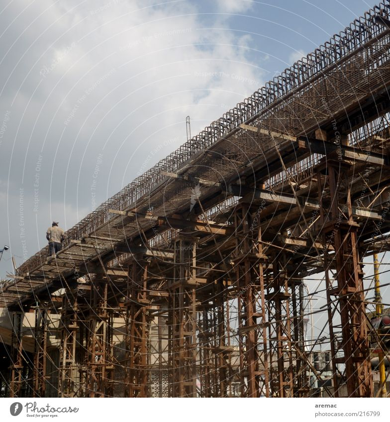 bridge building Human being Masculine 1 Bridge Manmade structures Brown Steel Construction site India Colour photo Subdued colour Exterior shot