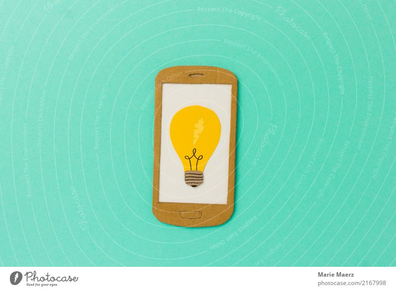 Learning & Research. Yellow bulb on mobile phone display. Education Telephone Cellphone PDA Internet Discover Study Reading Success Infinity Modern Curiosity
