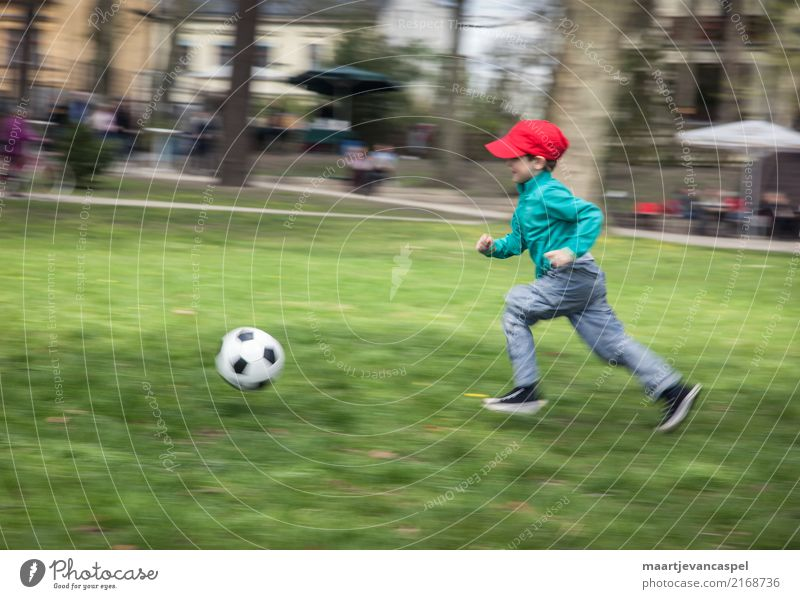 Little boy and football Athletic Leisure and hobbies Playing Sports Foot ball Human being Masculine Child Boy (child) Infancy Life 1 3 - 8 years Park Meadow