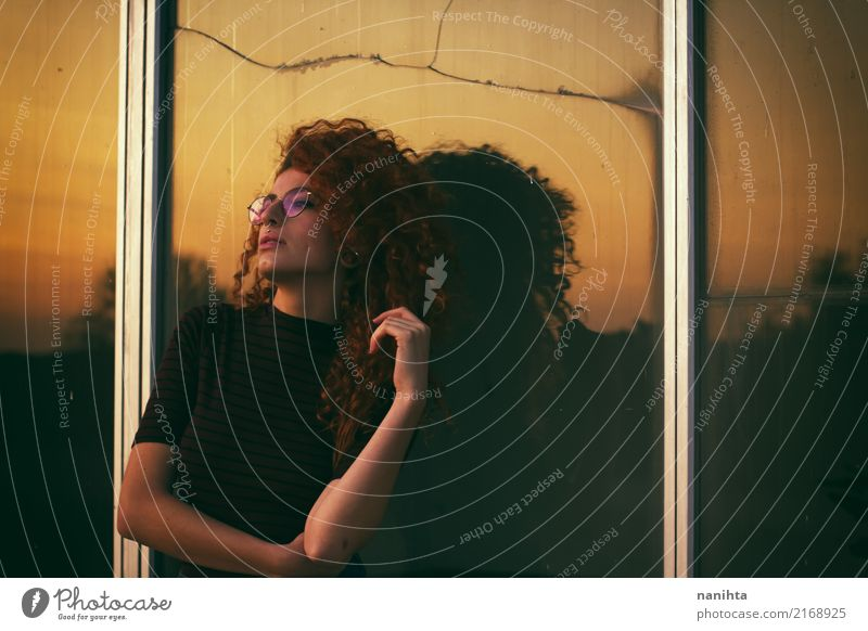 Young woman with the sunset as background Human being Vacation & Travel Youth (Young adults) Beautiful Window 18 - 30 years Black Adults Lifestyle Feminine