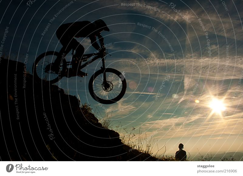 Human being Sun Sports Jump Bicycle Leisure and hobbies Driving Beautiful weather Territory Mountain bike Veil of cloud